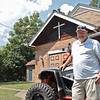 """The """"Bear Cave"""" owner Berry Smith stands in front of the church he converted into an ATV lodge for visitors in Mullens.  Jenny Harnish/The Register-Herald"""