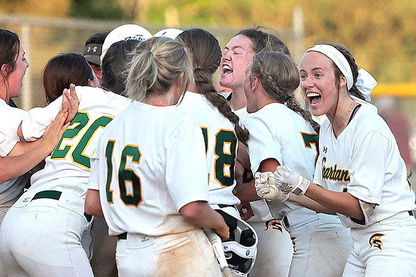 The Greenbrier East Spartans celebrate after winning the Class AAA Region 3 softball game against St. Albans in Fairlea Monday.  Jenny Harnish for the Register-Herald