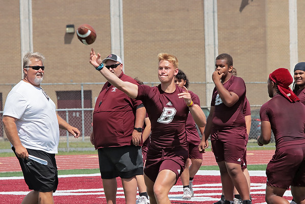 Woodrow Wilson quarterback Maddex McMillen throws the ball during the first day of three-week period Monday. Jenny Harnish/The Register-Herald