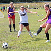 Woodrow Wilson soccer players Erika Hilliard, left, and Sidney Vaught battle for the ball during practice Tuesday at the YMCA Paul Cline Memorial Youth Sports Complex. Jenny Harnish/The Register-Herald
