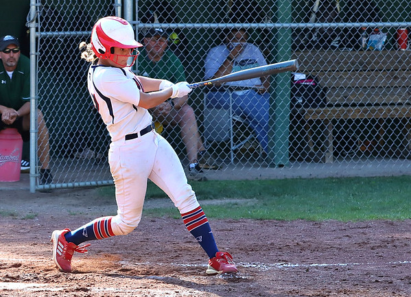 Kaylen Parks of Independence knocks one over the fence to give the Lady Patriots an early 1-0 lead.