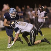 Meadow Bridge wide receiver, James McClure attempts to get around Greebrier West's Chase McClung. Chad Foreman for the Register-Herald.