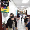 Theresa Lewis, principal Crescent Elementary School, left, monitoring students walking up the hallway. Crescent was awarded the Blue Ribbon School.