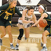 Woodrow's Cloey Frantz scrambles for a loose ball around Greenbrier East's Brooklyn Morgan and Allie Dunford. Jon C. Hancock/for The Register-Herald
