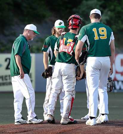 Coach Tim Epling for the WV Miners calls for a timeout on the  mound. <br /> Tina Laney/for The Register-Herald