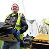 "David ""Rockstar"" Cook, left and Russel Potter, Beckley Board of Public Works employees, load up material in Ward 1 on Westwood Drive during the City's annual  Spring Clean-up, a popular free service that the City of Beckley offers annually to citizens. Work crews with two loaders and twenty trucks working in Ward 1 and 2 were experiencing larger than nomal loads this year because it was suspended in April 2020 due to COVID-19 concerns. The Public Works Department started collecting spring cleanup items on Monday, April 19 and will continue for the next couple weeks until they reach every street in thier five wards.<br /> <br /> All items in all wards are to be placed within 5 feet of the curb and no return visits will be made to any streets after it has been completed. The City will not pick up, tires, hazardous waste, petroleum products. (oil, gasoline, etc.) Yard Waste. (tree limbs, logs, brush) Demolition materials, batteries, liquids. (paint thinners, pesticides, or insecticides) No white goods. (washers, dryers, or refrigerators, freezers, air conditioners, or stoves)<br /> (Rick Barbero/The Register-Herald)"