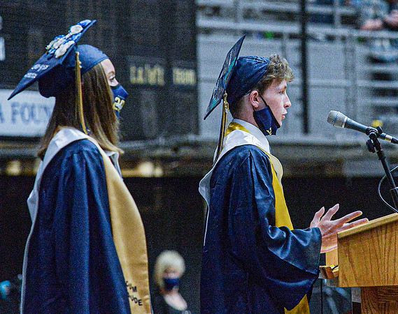 F. Brian Ferguson/Register-Herald  Jessica York, left, and Austin Webb, both members of the National Honor Society, speak to their fellow classmates during Friday's Shady Spring High School Commencement at the Beckley-Raleigh County Convention Center.