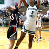 Daisha Summers (Wyoming East) sinks 2 over Gavin Pivont (Summers County).