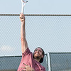 Ryan Moss serves it up during the summer tennis league finals held at Woodrow Wilson. Chad Foreman for the Register-Herald.