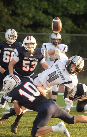 Independence's Judah Price tackles Westside's Blake Bledsoe causing a fumble in the first quarter. Jon C. Hancock/for the Register-Herald