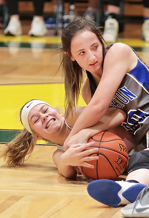 Greenbrier East's (33) battle's Princeton's (20) during Tuesday's game at Greenbrier East High School in Fairlea.  Jenny Harnish for the Register-Herald