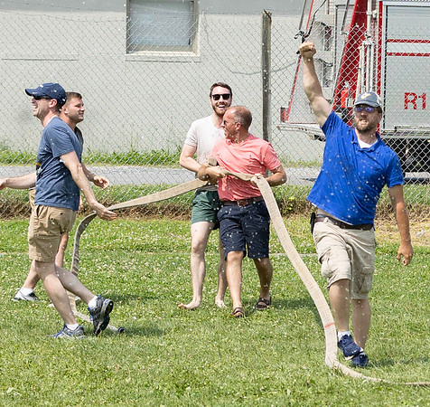 Greenbrier County men pictured left to right Josh, Kaleb, Jordan, Robert, Aaron are victorious in the 2021 Alderson 4th of July Celebration Tug of War. <br /> Tina Laney/for The Register-Herald