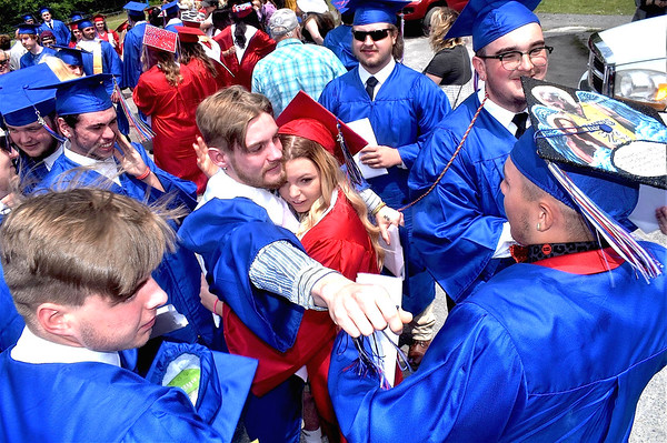 Midland Trail High School Class of 2021 graduates, including Trevor Maichle and Taylor Brown in center, celebrate after they accepted their diplomas on Saturday at Roger Eades Field in Hico.<br /> (Steve Keenan/The Register-Herald)