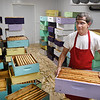 Michael Deckner, Appalachian Headwaters, carries one of many bee hive boxes from the freezer/hot room to begining the extracting process for making honey at Camp Waldo in Hinton<br /> (Rick Barbero/The Register-Herald)