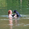 Kaelan Howell and her puppy Spencer, from Rainelle, go for a swim at Blue Bend Recreation Area in the Monongahela National Forest Monday. Jenny Harnish/The Register-Herald