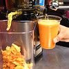 Dinesh Lamichhane, making a Immune Booster Cold Press Juice at Jimmie's Place on South Kanawha Street in Beckley.<br /> (Rick Barbero/The Register-Herald)