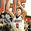 Liberty's A.J. Williams puts up a jumpshot over Independence's A.J. Zilinski during the first half. Jon C. Hancock/for The Register-Herald