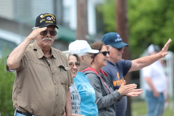 Vietnam era veteran Mark Williams salutes veterans riding in the Remember the Fallen Ride 2021 in Rainelle Thursday.  Jenny Harnish for the Register-Herald