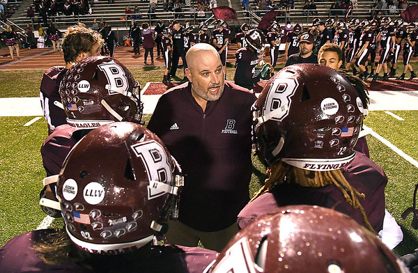 Woodrow Wilson head coach Street Sarrett, speaks to his team during a timeout during game against Morgantown held at Woodrow Wilson High School.<br /> (Rick Barbero/The Register-Herald)