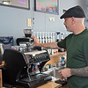 The Coal Bucket coffee shop owner Aubrey Dickerson makes an espresso at the newly re-opened shop in Mt. Hope Thursday.  Jenny Harnish/The Register-Herald. Jenny Harnish/The Register-Herald
