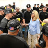 Congresswoman Carol Miller (R-WV), speak with Blackhawk mine rescue team before the start of the Fallen Heroes Mine Rescue Contest  at Sylvester Pavilion Park in Boone County. Ten mining compnay teams competed to solved hypothetical mine-related problems while being timed and observed by judges. The contest is intended to promote mine safety by sharpening the skills of miners who may be called to respond to a mine emergency in the future.<br /> (Rick Barbero/The Register-Herald)