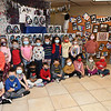 Jane Atinson, pre-k students at St. Francis de Sales school in Beckley pose for a photo near some of their artwork they produced for their annual fund raising art gallery that's on display in the school. Atinson said, this was a two month project with students producing 400 pieces of art that are displayed in 15 seperate exhibits. Members of the church, staff members, students. parents and grandparents are able to view the gallery Thursday and Friday in the parish hall between 8 am and 2:30 p.m. and can purchase a piece of artwork in a frame for $10.  The fund raiser helps to buy art supplies and other activities.<br /> (Rick Barbero/The Register-Herald)