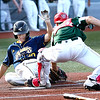 #30 for the Lafayette Aviators slides safely into home plate against catcher Straton Podaras for the WV Miners.<br /> Tina Laney/for The Register-Herald
