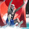 Grant Woodson slides into the water at the White Sulphur Springs City Pool Monday. The new pool and wellness center celebrated its opening Memorial Day weekend with free passes for White Sulphur Springs residents.  Jenny Harnish for the Register-Herald