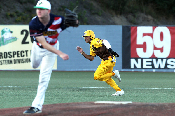 Millrats Christian Scott steals third base during a game with the Miners. Jon C. Hancock/for the Register-Herald