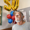 Postal Clerk John Obugene, right, was honor for his 50 years of dedicated service at a special ceremony on Wednesday, August 11, at Beckley Post Office on 134 Industrial Dr. Obugene's family members, coworkers, and several former coworkers attended the surprise event.<br /> (Rick Barbero/THe Register-Herald)