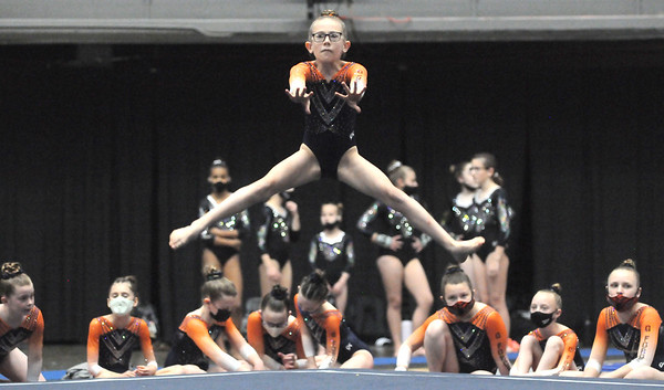 Katherine Umbright from WVGTC performs her routine on the floor exercise during Sesson 3 of the WV USAG meet at the Armory. Jon C. Hancock/for The Register-Herald