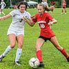 F. Brian Ferguson/Register-Herald Greenbrier East's Kennedy Morgan, left, and Oak Hill's Kerrisyn Feazell converge on the ball during Tuesday evening action in Oak Hill.