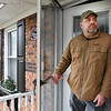 Beckley VA Medical Center nurse Eric Jefferies tested postive for COVID-19 stands in the doorway of his home on Robin Roost Road in Jumping Branch. Jefferies will be in isolation until Sunday, January 10.<br /> (Rick Barbero/The Register-Herald)