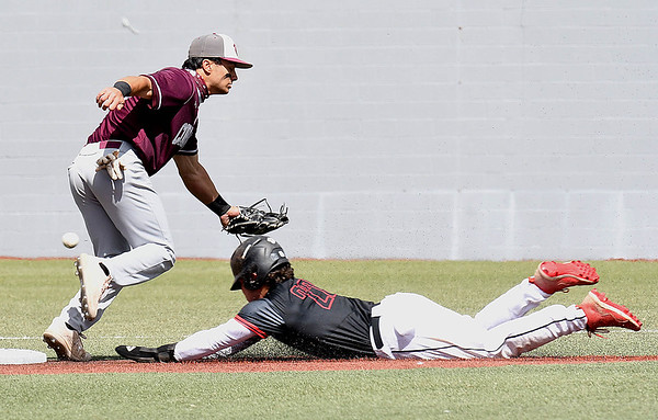 Zac Saryeldin, left of Concord, misses a throw to second on a steal by Blake Vandiver, of Wheeling.<br /> (Rick Barbero/The Register-Herald)