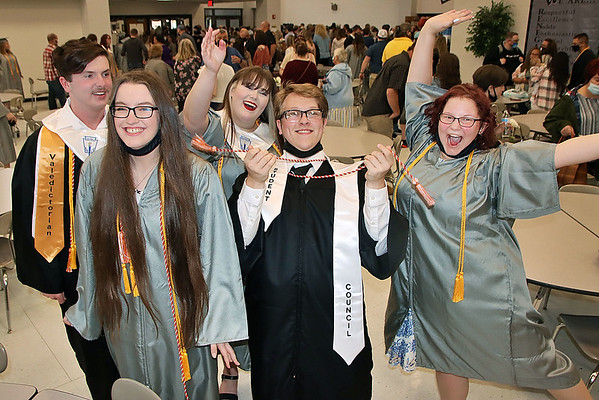 Westside graduates Thomas Toler, Lindsey Walls, Rylee England, Chris Goff, and Kassidee Lovins celebrate following their graduation Saturday.<br /> Jim Cook for the Register-Herald