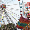 Workers do maintenance on a ride at the State Fair of West Virginia Monday.  Jenny Harnish/The Register-Herald