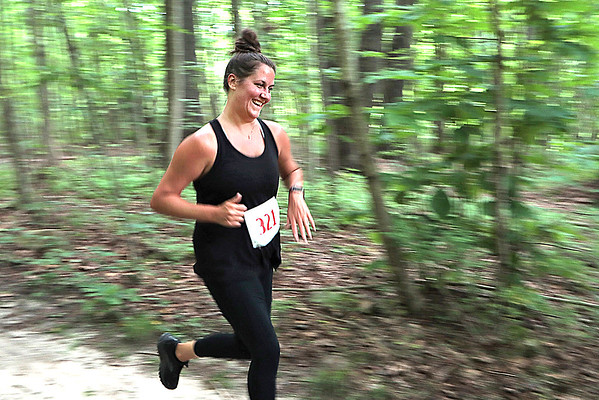 A runner makes her way down the trail during the 2nd Annual Weathered Ground 5k/10k Trail Run at the YMCA Paul Cline Memorial Sports Complex in Beckley Saturday. Jenny Harnish for the Register-Herald