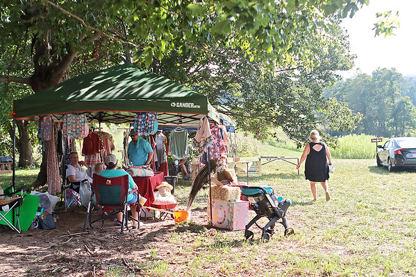Vendors are set up at Perk Farm Organic Dairy in Frankford Saturday. The farm has started hosting weekend activities including cow petting, vendors, sunflower picking and other activities for children and adults. Jenny Harnish/The Register-Herald