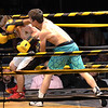 River Simms on the left lost against Trevor Bell during the Toughman Contest.<br /> Tina Laney/for The Register-Herald