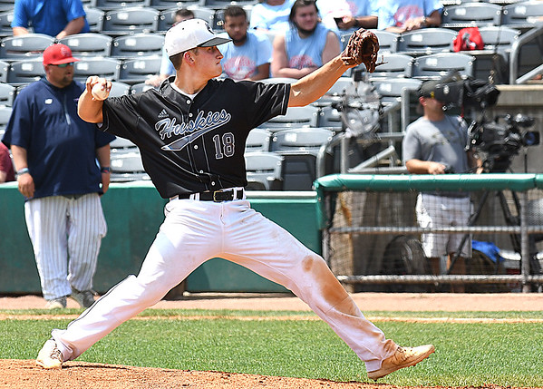 Jace Rinehart, of North Marion, delivers a pitch against Independence, during the semi-final State Baseball Tournament held at Appalachian Power Park in Charleston Friday morning.<br /> (Rick Barbero/The Register-Herald)