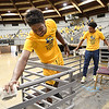 """Chance Potter, left, and Juvantie Hayes, both basketball players for WVU Tech and 200 other Tech students particiapted in the Golden Bears """"Give Back Day of Service"""" working on various projects at the Beckley-Raleigh County Convention Center Tuesday morning from 9 am to noon."""
