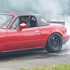 Brandon Bailey making some smoke with his 1997 Mazda Miata during the Burnout Contest at the Friends of Charity Auto Fair<br /> Tina Laney/for The Register-Herald
