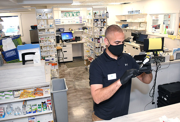 Eppy's Drug pharmacist Jason Gevenosky prepares a COVID-19 vaccine at the store on Robert C Byrd Drive in Beckley.<br /> (Rick Barbero/The Register-Herald)