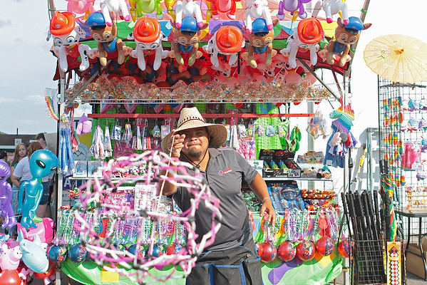 Ramon Arguello sells spear balls at the State Fair of West Virginia on opening day in Fairlea Thursday. Jenny Harnish/The Register-Herald