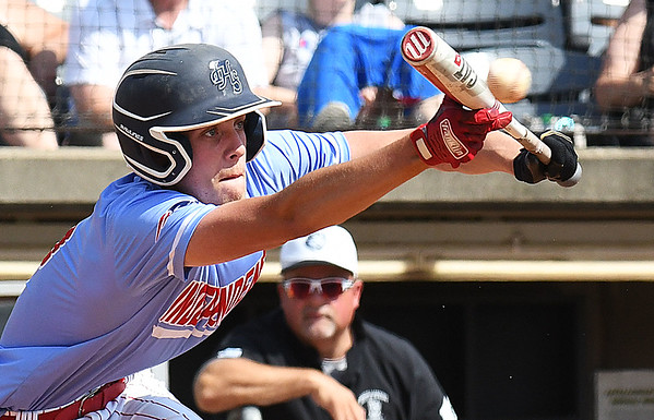 Kaleb Daniels, of Independence, lays down a bunt against North Marion during the semi-final State Baseball Tournament held at Appalachian Power Park in Charleston Friday morning.<br /> (Rick Barbero/The Register-Herald)