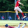 Michael McKinney of Independence jumps for a throw while Ryker Brown of Bluefield slides safely into 2nd base. <br /> Tina Laney for Register-Herald
