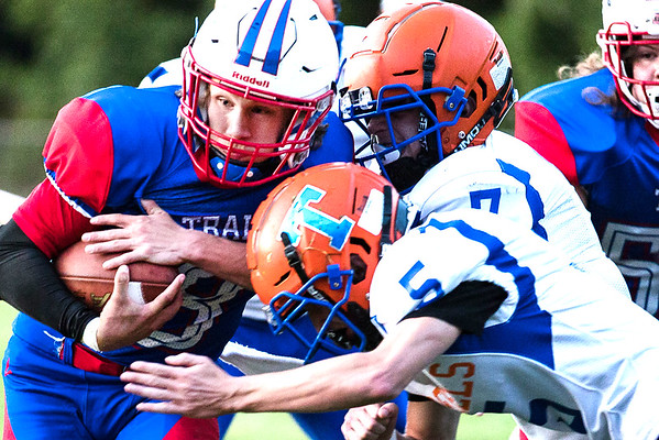 Midland Trail running back, Zane Burford attempts to break through the Rebel defense while Eli Blackburn (5) goes to wrap him up. Chad Foreman for the Register-Herald.