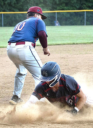 MIchael Mckinney sliding safe into 3rd base under Carson Deeb<br /> Tina Laney for The Register Herald