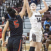 Oak Hill's Samiah Lynch defends as Woodrow Wilson's Olivia Zolkowski puts up a score during Tuesday evening action in Beckley. F. Brian Ferguson