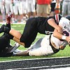 Atticus Goodson, of Independence, gets tackled Liberty defenders as he crosses the endzone for a touchdown in the first quarter at Liberty High School Friday night.<br /> (Rick Barbero/The Register-Herald)